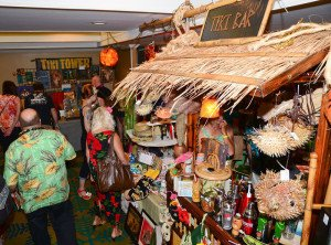 Attendees browse last year's Tiki Treasures Bazaar at The Hukilau in June at the Sheraton Beach Hotel