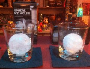 Removed from their molds, the ice spheres await a cocktail