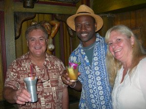 "Mai-Kai owner Dave Levy (left) and marketing director Pia Dahlquist welcome Miami Rum Festival judge and seminar presenter Ian ""Rum Ambassador"" Burrell to Tuesday night's party"