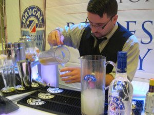A Brugal Rum rep pours classic Bee's Knees cocktails during the Grand Tasting at the Miami Rum Festival on Saturday, April 26