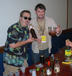 Rum Fest organizer Robert V. Burr (left) heartily endorses Tyler Kok's homemade falernum after a seminar on The Flavor of Barbados
