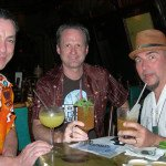 "Adjourning to The Mai-Kai on Saturday night, Hurricane Hayward is flanked by Tim ""Swanky"" Glazner of Swank Pad Productions (left) and Otto von Stroheim of Tiki Oasis as they enjoy classic tropical cocktails"