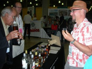 Otto von Stroheim of Tiki Oasis samples the exotic Dzama Rhum from Madagascar
