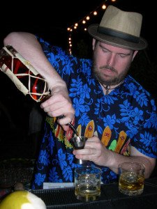 Matt Robold pours Plantation Rum as he mixes up Caña Rum Bar cocktails