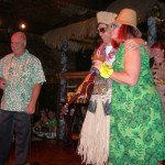 "Owner Dave Levy introduces The Mai-Kai's Kern Mattei and Pia Dahlquist, who do their best impersonation of King Kukulele and The Hukilau's Christie ""Tiki Kiliki"" White (far right) at The Hukilau in June 2014. (Photo by Hurricane Hayward)"
