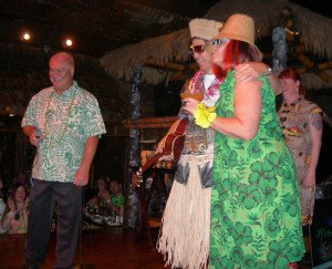 """Owner Dave Levy introduces The Mai-Kai's Kern Mattei and Pia Dahlquist, who do their best impersonation of King Kukulele and The Hukilau's Christie """"Tiki Kiliki"""" White (far right) at The Hukilau in June 2014. (Photo by Hurricane Hayward)"""