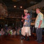 Mai-Kai manager Kern Mattei belts out a King Kukulele number as amused audience members and owner Dave Levy look on.