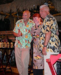 "The Hukilau's Christie ""Tiki Kiliki"" White introduces her new partners, Richard Oneslager (left) and Mike Zielinski, during Saturday night's Main Event at The Mai-Kai."