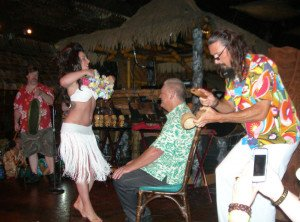 Burlesque star Angie Pontani presents Mai-Kai owner Dave Levy with a ceremonial mystery dance, with a little help from Crazy Al Evans, during Saturday night's Main Event during The Hukilau 2014.