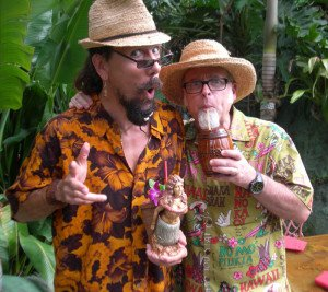 "Artist Crazy Al Evans and author Jeff ""Beachbum"" Berry enjoy cocktails in The Mai-Kai's tropical garden at The Hukilau in June 2014"