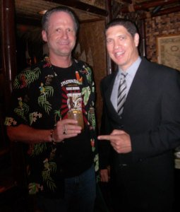 Kern Mattei (right), general manager of The Mai-Kai and the brains behind the 'Potions of the Caribbean' cocktail flight, presents Hurricane Hayward with the Virgin Island Kula