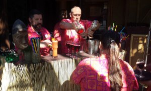 Bartenders are hard at work mixing up Trader Sam's Zombie Head Punch.
