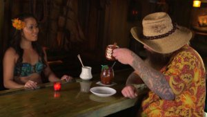 Roro serves a flaming Kona Coffee Grog to the Cooking Channel's Jim Stacy