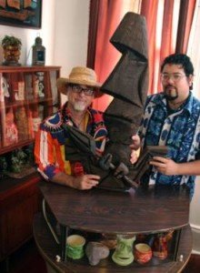 Beachbum Berry (left) and Latitude 29 co-general manager Steve Yamada with a Tiki object by Bosko