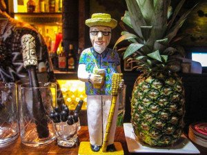 A mini Beachbum adorns the bar at Latitude 29