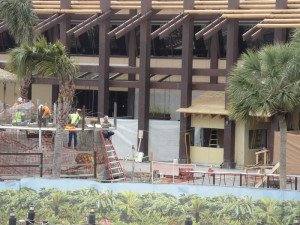 The service bar for Trader Sam's Grog Grotto, the roofed structure to the right, is being built on the back of the Great Ceremonial House.  (Feb. 26, 2015)