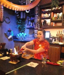 A bartender at Trader Sam's Grog Grotto lights the flaming Uh-Oa! on March 31, 2015