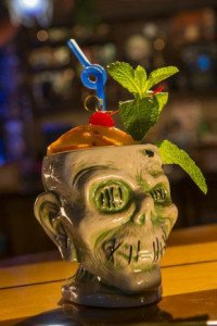 The Shrunken Zombie Head contains Goslings 151 rum, Appleton Estate Reserve rum, Bacardi 8 rum, tropical juices, falernum, and cinnamon