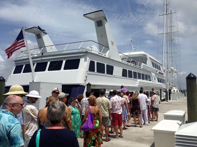 The line forms to gain entry to the 170-foot Lady Windridge Yacht at one of the docks at the Hyatt Regency Pier 66. (Jeff Chenault photo)