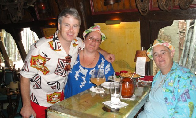 "Artist Dave ""Basement Kahuna"" Wolfe joins festival regulars Chanda Shaffer (left) and Beth Griffiths of Port St. Lucie for one last day of revelry in The Molokai. (Atomic Grog photo)"