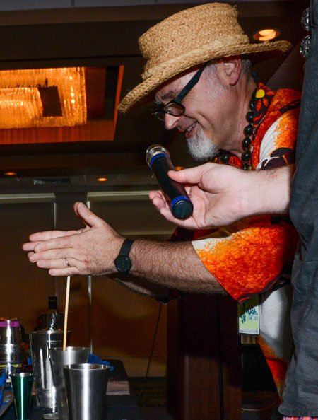 Beachbum Berry, who has released his own line of vintage barware via Cocktail Kingdom, demonstrates how to use an authentic swizzle stick. (Photo by Go11Events.com)