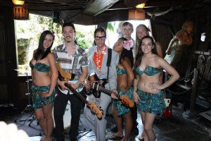 Skinny Jimmy Stingray and his band make quite an impression on the Molokai Girls. (Photo by The Tanabi Group)