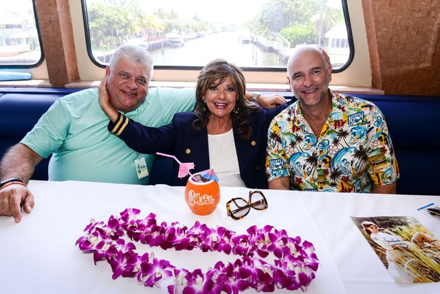 The Hukilau's new partners, Mike Zielinski (left) and Richard Oneslager, are happy to be cruising with Dawn Wells. (Photo by Go11Events.com)