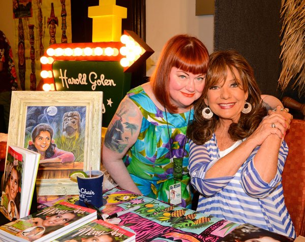 "The Hukilau's co-producer and co-founder, Christie ""Tiki Kiliki"" White, greets special guest Dawn Wells, star of the classic TV series Gilligan's Island. (Photo by Go11Events.com)"