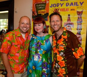 "The Hukilau's Christie ""Tiki Kiliki"" White welcomes artists Kevin Kidney (right) and Jody Daily, who presented a symposium on Disney World's Polynesian Village in June 2015.  (Photo by Go11Events.com)"