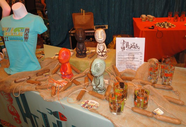 The Hukilau merchandise table included mugs by Tiki Diablo, pendants by Perry Drake, plus glassware and T-shirts with designs by Michael Uhlenkott. (Atomic Grog photo)