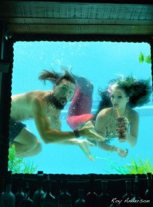 Artist Crazy Al Evans drops in on Marina the Fire Eating Mermaid during her swim show at The Wreck Bar during The Hukilau 2015
