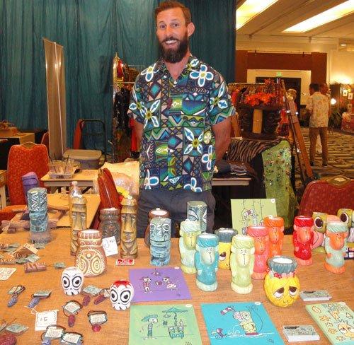 California artist Tiki Tony shows off a variety of mugs, pendants and artwork. (Atomic Grog photo)