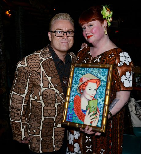 "Artist Rod North presents The Hukilau's Christie ""Tiki Kiliki"" White with a portrait he painted for her. (Photo by Go11Events.com)"