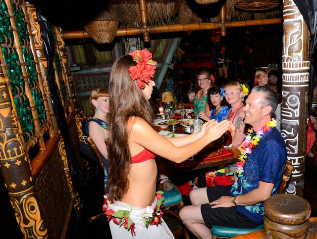 A guest is treated to a dance from The Mai-Kai's Mystery Girl after ordering a Mystery Drink during The Hukilau in June 2015. (Photo by Go11Events.com)