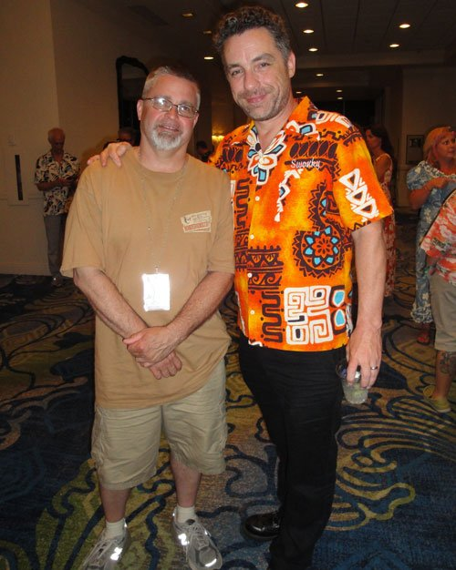 "Author and exotica music expert Jeff Chenault (left) greets The Hukilau co-founder and author of an upcoming book on The Mai-Kai, Tim ""Swanky"" Glazner. Burlesque dancer Lila Starlet also performed between band sets. (Atomic Grog photo)"