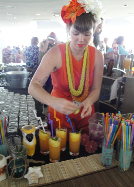 Shelby Allison works on the elaborate garnish for the Lost Lake cocktail