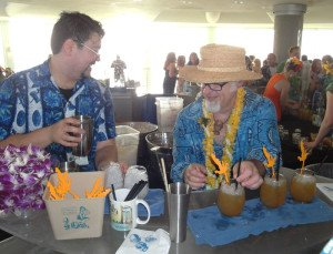 "Steve Yamada (left) and Jeff ""Beachbum"" Berry crank out the T.O.T.C. Swizzle during the Tiki Tower Takeover at The Hukilau on June 11, 2015. (Photo by Hurricane Hayward)"