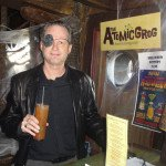 "Hurricane Hayward (aka The Governor from ""The Walking Dead"") arrives early to spin the retro tunes (and drink a few Zombies). (Atomic Grog photo)"