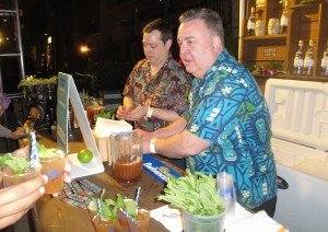 Foundation Tiki Bar in Milwaukee is represented by bartender Michael Kotke (left) and manager Don Nelson, who serve up the Ti-Bon-Ange cocktail.