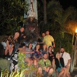 The Porco Lounge & Tiki Room crew pay their respects to the giant Tiki outside The Mai-Kai.