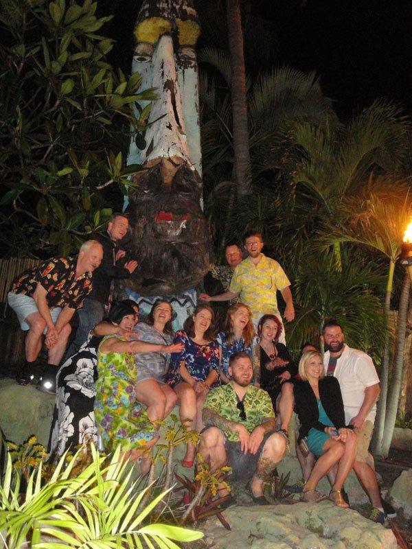 The Porco Lounge & Tiki Room crew pay their respects to the giant Tiki outside The Mai-Kai.