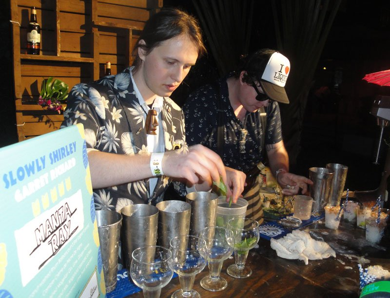 Bartender Garret Richard of Slowly Shirley in New York City prepares his Manta Ray cocktail with assistance from Sean Saunders.