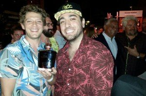 Bartenders Gui Jaroschy (left) and Randy Perez of The Broken Shaker celebrate their victory in The Art of Tiki: A Cocktail Showdown at the South Beach Wine & Food Festival on Friday, Feb. 26. Among the prizes was a rare bottle from sponsor Rhum Barbancourt. (Atomic Grog photo)