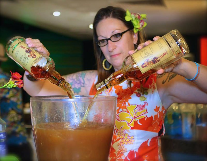 Tonga Hut mixologist Marie King creates a special drink featuring sponsor Sailor Jerry rum during the Modernism Week party Feb. 12 at the Caliente Tropics in Palm Springs. (Photo by Kari Hendler from Poly Hai)
