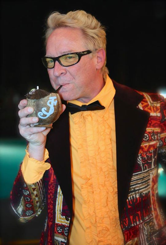 Host Shag enjoys a cocktail during the poolside Modernism Week party held Feb. 12 at the Caliente Tropics Resort Hotel. (Photo by Kari Hendler from Poly Hai)