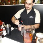 A mixologist at the Rums of Puerto Rico booth prepares a cocktail.