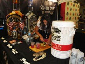 A Bayou Rum representative prepares cocktails.