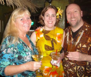 "The Mai-Kai's Pia Dahlquist welcomes Rebecca and Martin Cate, authors of the upcoming book ""Smuggler's Cove: Exotic Cocktails, Rum and the Cult of Tiki."" (Photo by Hurricane Hayward)"