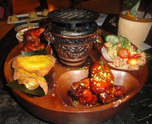 The Naked Tiki's Pupu Platter includes chicken wings, BBQ spare ribs, Crab Rangoon, tuna poke, and Steak Negimaki.  (Photo by Hurricane Hayward)