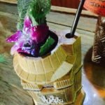 The Hukilau's Tower Barrel Mug is a mash-up of the tower building at the Pier 66 hotel and The Mai-Kai's Barrel O' Rum.